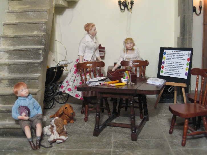 Miss Esther and Alice are busy preparing the Advent lesson for the children.  Robert Alexander is seen lounging on the bell tower steps with a purple cabbage and Georgie, his dog, is sitting at his feet.