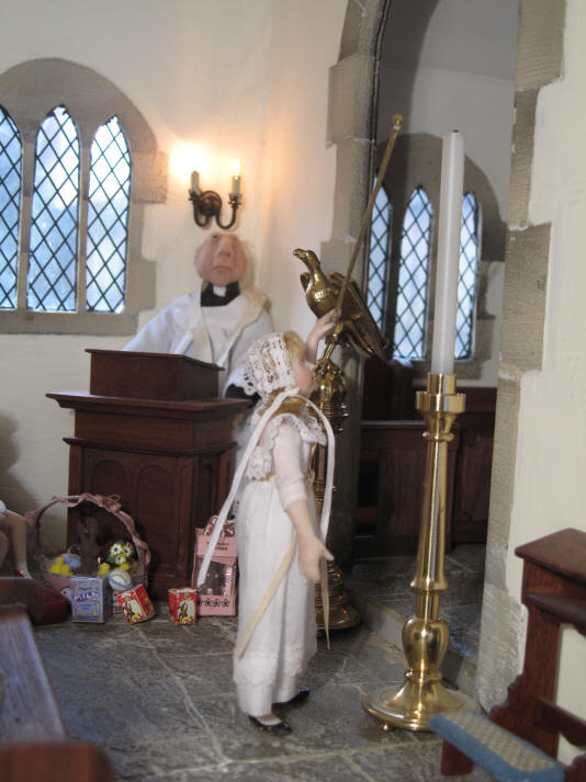 Alice volunteers to light the Paschal candle this year and is just practising to make sure she can reach!