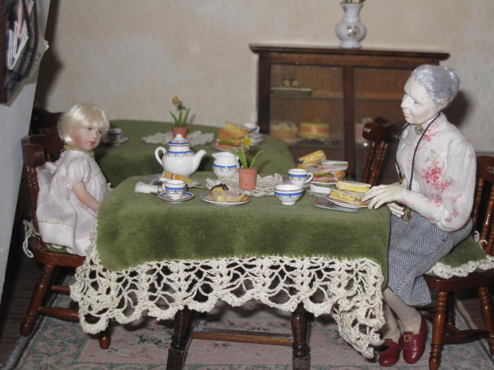 Alice serves Miss Enid and Alice and they are now enjoying some sandwiches and cakes and, of course, a nice cup of tea!