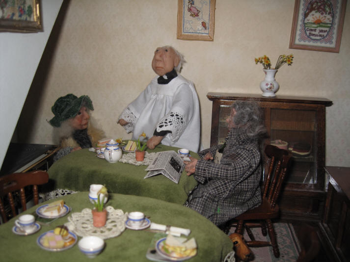 Homer and Rita enjoy a spot of warmth in Aunt Sal's Tearooms whilst having a spot of lunch courtesy of kind Archie who owns the tearooms.  The vicar has come in for a chat!