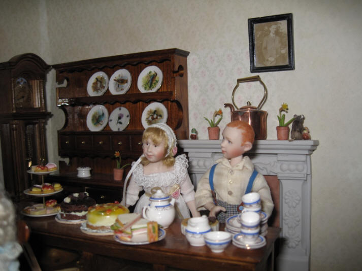 Ambrose and Alice are now ready to set the tables with tea and cakes for the children now they have finished thier work...