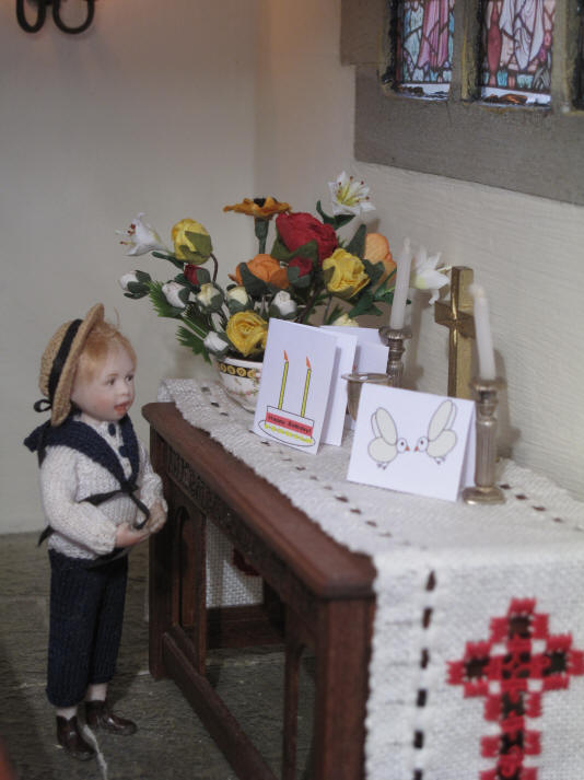 Tom's card has a birthday cake on it!  He is VERY proud of it as it now sits on the altar with the other two cards.