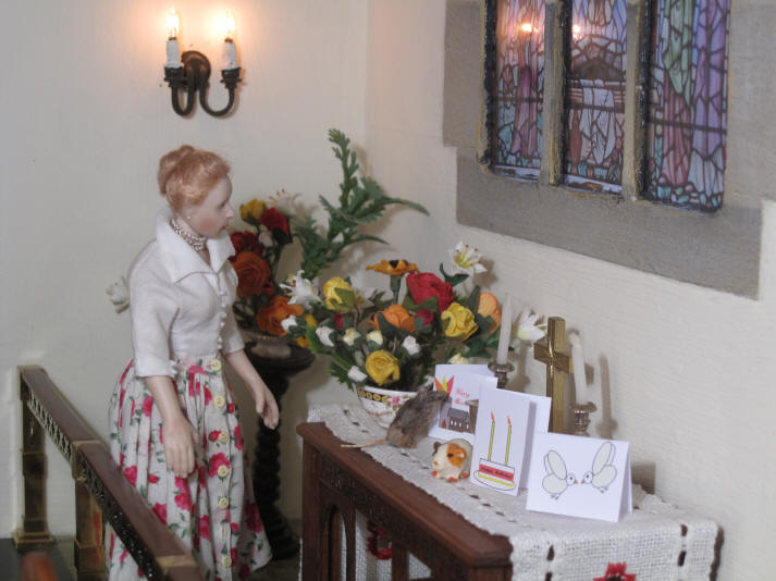 Esther, who has arranged all of the church flowers for this Pentecost celebration, is inspecting them to make sure everything is in good order for the service..........