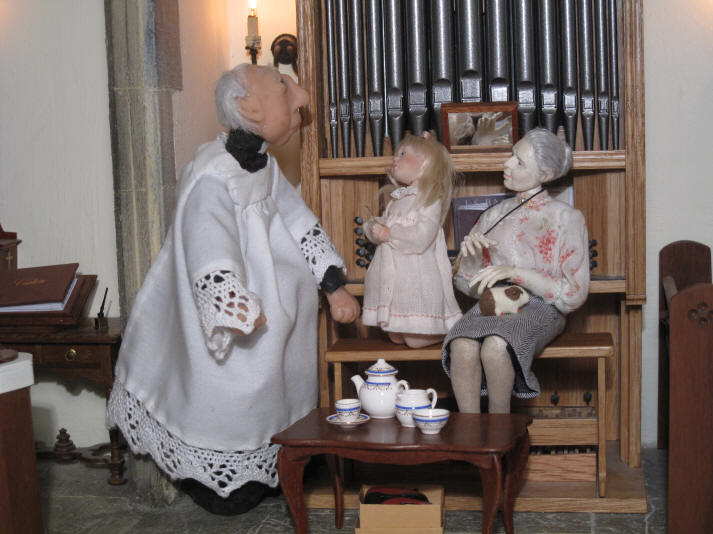 Priscilla Jane tells the vicar that she has found the teaspoon and is showing it off to him!