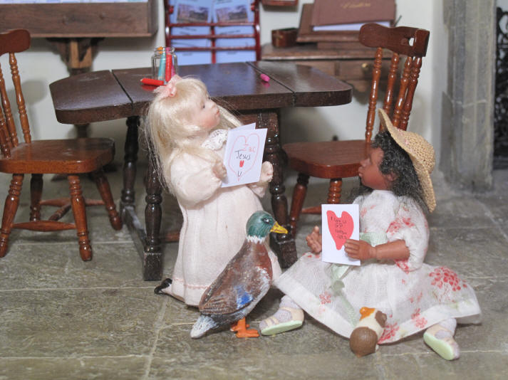 Gracie and Priscilla Jane show off their now finished Valentine's Day cards to each other...